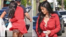 Kylie Jenner Flashes Her Spanx As A Gust Of Wind Lifts Up Her Tiny Red Dress!