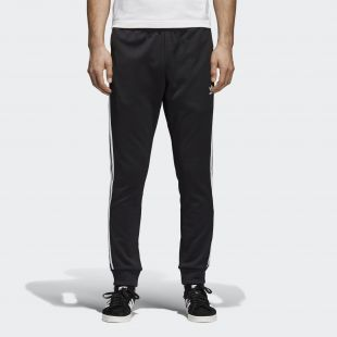 The jogging bottoms black with white stripes Adidas worn by