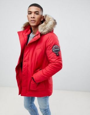 Superdry Everest hooded parka jacket with faux fur trim in red at asos.com