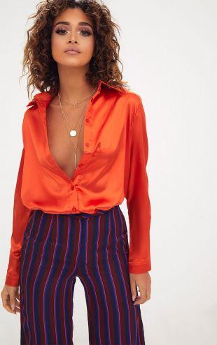 Chemise en soie satinée orange boutonnée devant
