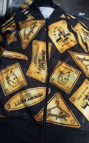 The bomber jacket Adidas Jeremy Scott of Eggsy (Taron