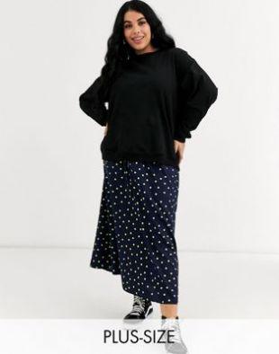 Wednesday's Girl Curve - Jupe mi-longue à fermeture éclair sur le devant et motif pois aux couleurs vives | ASOS