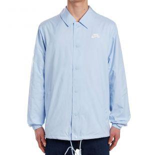 La veste chemise Nike SB grise avec logo blanc portée par Jok'Air ...