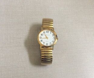 Oleg Cassini Gold Women's Watch Round White Dial with Easy to Read Black Arabic Numbered Hours Gold Stretch Band vintage Mint Condition Rare