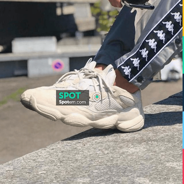 The pair of Adidas Yeezy 500 Blush that door so_style on his