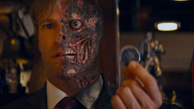 Two-Face's coin of Harvey Dent (Aaron Eckhart) as seen in The Dark Knight