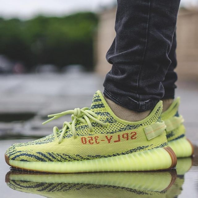 newest f3e52 3231b the pair of the Adidas Yeezy Boost 350 V2 Semi Frozen Yellow ...