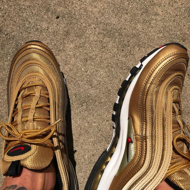 The pair of Nike Air Max 97 OG QS Gold Bullet on the account