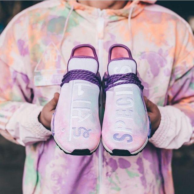 The pair Adidas Human Race NMD Pharrell