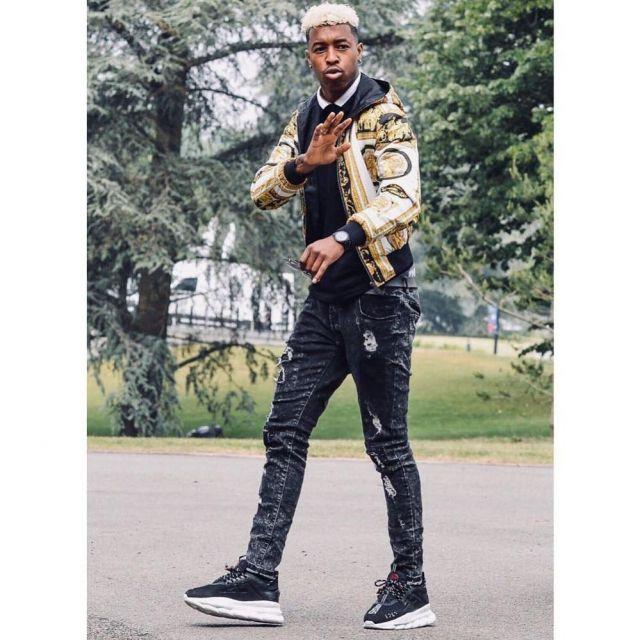 La paire de sneakers Chain Reaction Noires par Versace
