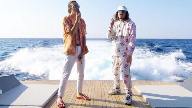 """Les claquettes rouges Adidas de Charles Vicomte dans le video clip """"Champagne & Pétou"""" de Lorenzo"""