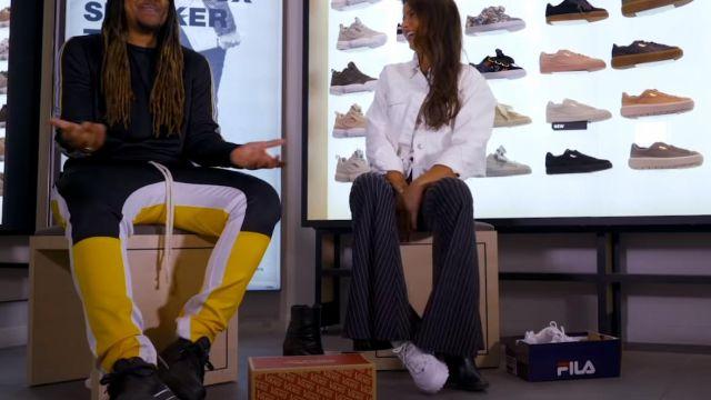 Les sneakers Fila Disruptor portées par Malika Ménard dans MALIKA MENARD – Bail 2 Sneakers