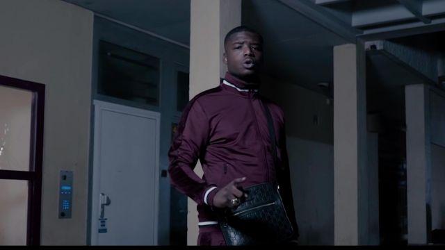La sacoche Gucci noire portée par Ninho dans le clip Entre les murs de Da Uzi
