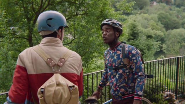 Zara Blue jacket with patches on it worn by Eric (Ncuti Gatwa) as seen in Sex Education S01E02
