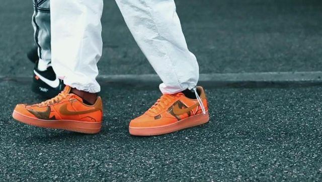 The pair of Nike Air Force 1 '07 LV8 3 Realtree orange Koba