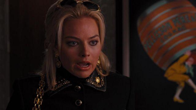 Gianni Versace Medusa dangling earrings worn by Naomi Lapaglia (Margot Robbie) in The Wolf of Wall Street