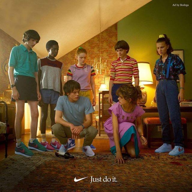 Sneakers white with logo Nike orange worn by Millie Bobby