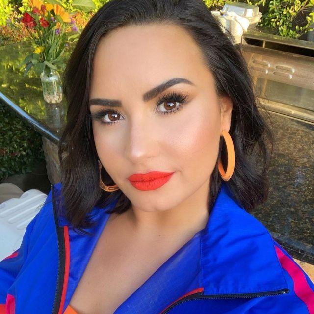 Alison Lou Neon Medium Jelly Hoops Loucite worn by Demi Lovato on her Instagram account @ddlovato
