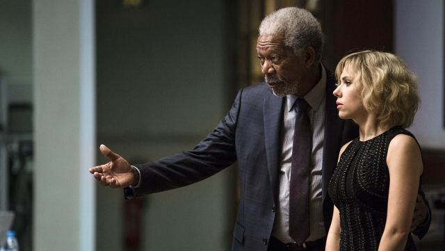 The gray suit worn by the Professor Norman (Morgan Freeman) in Lucy