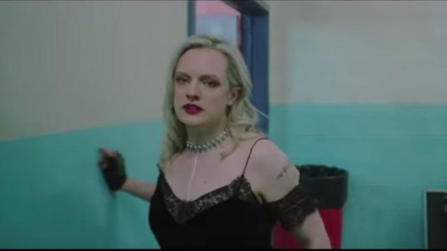 Black lace top with open shoulder worn by Becky Something (Elisabeth Moss) in the trailer of Her Smell