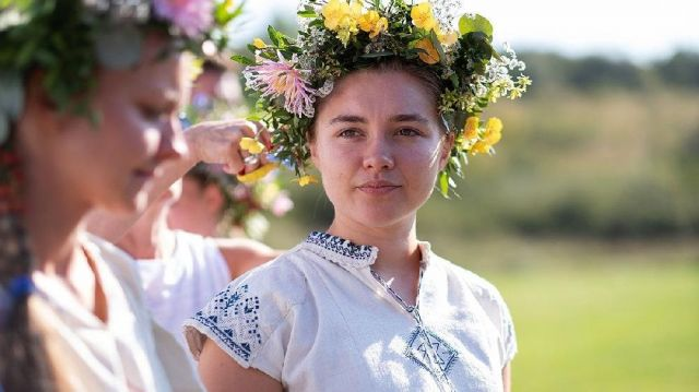 Short sleeve white blouse with blue embroidery worn by Dani (Florence Pugh) in Midsommar