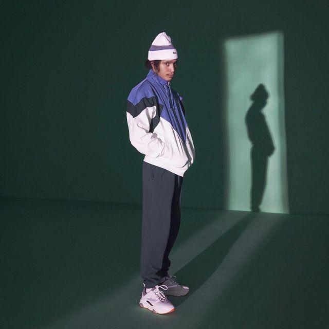 La veste Lacoste et les sneakers Dior portés par Moha La Squale sur son compte Instagram @mohalasquale