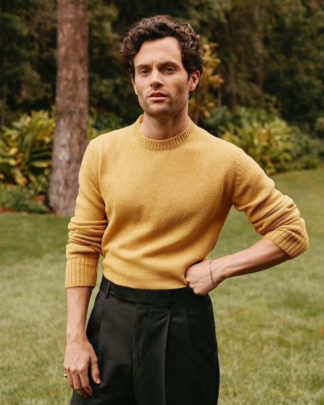 The sweater yellow worn by Penn Badgley for a photoshoot