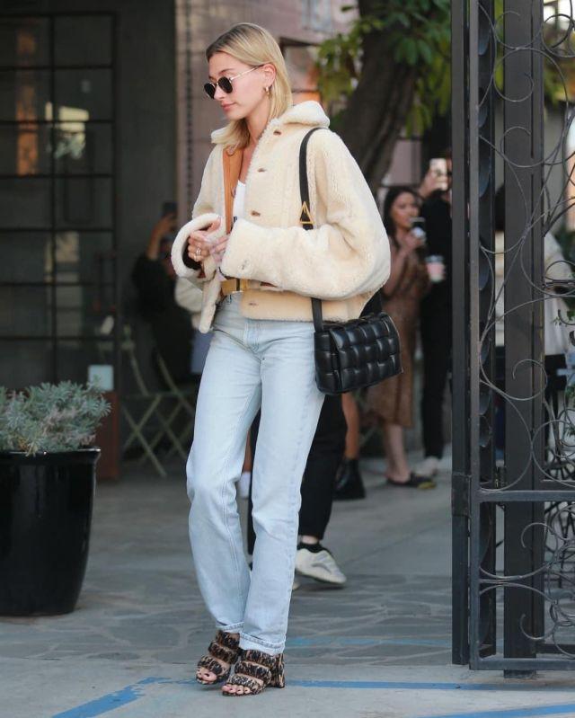 Saint Laurent New Wave Sunglasses worn by Hailey Baldwin Nine Zero One Salon Los Angeles January 4, 2020