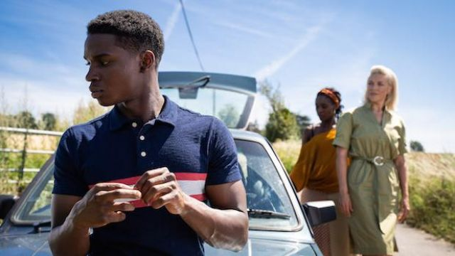 The polo blue with red stripes Jackson Marchetti (Kedar Williams-Stirling) in Sex Education (Season 2 Episode 7)