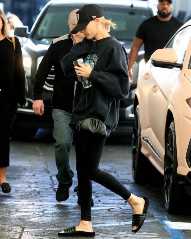 Bottega Veneta Black Small The Pouch Clutch worn by Hailey Baldwin Beverly Hills February 17, 2020