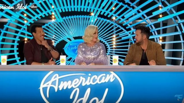 Jenny packham Lili Feath­er-Trimmed Se­quined Jump­suit worn by Katy Perry on American Idol February 16, 2020