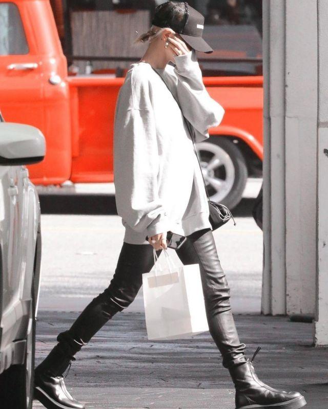 Bottega Veneta Black Small The Pouch Clutch worn by Hailey Baldwin Los Angeles February 18, 2020