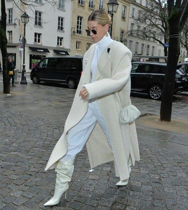 Bottega Veneta Off White Small The Pouch Clutch worn by Hailey Baldwin Paris February 27, 2020