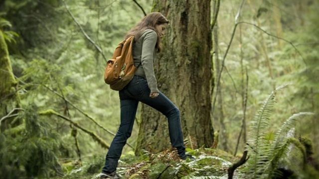 Jansport backpack in orange brown worn by Bella Swan (Kristen Stewart) in The Twilight Saga: New Moon