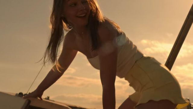 The short yellow worn by Sarah Cameron (Madelyn Cline) in Outer Banks Season 1 Episode 2