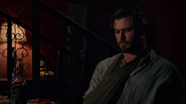 Buttoned-up collared shirt worn by Tyler Rake (Chris Hemsworth) in Extraction