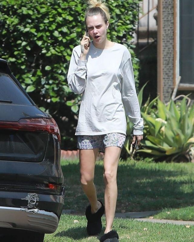 UGG Genuine Shearling Slipper worn by Cara Delevingne Los Angeles May 13, 2020