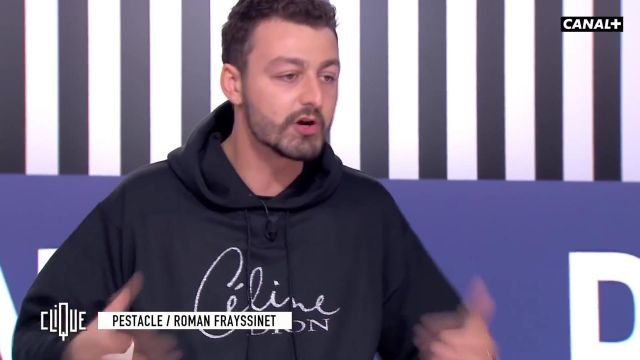 Le sweatshirt à capuche noir Céline Dion à strass de Roman Frayssinet dans l'émission Clique