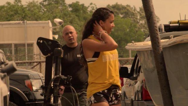 Black striped bikini top worn by Kiara (Madison Bailey) in Outer Banks (S01E03)