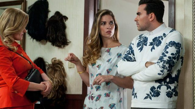 White sweater with blue floral worn by David Rose (Dan Levy) as seen in Schitt's Creek S01E11