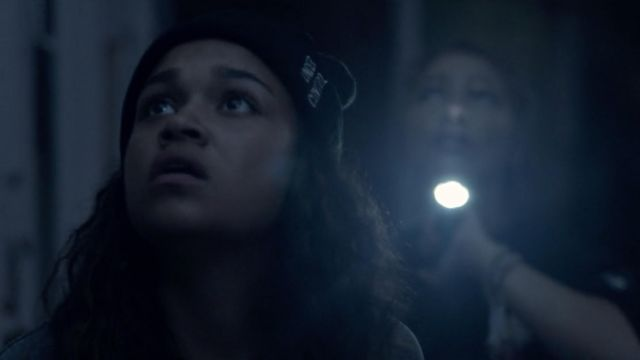 Black under control beanie worn by Kiara (Madison Bailey) in Outer Banks (S01E06)