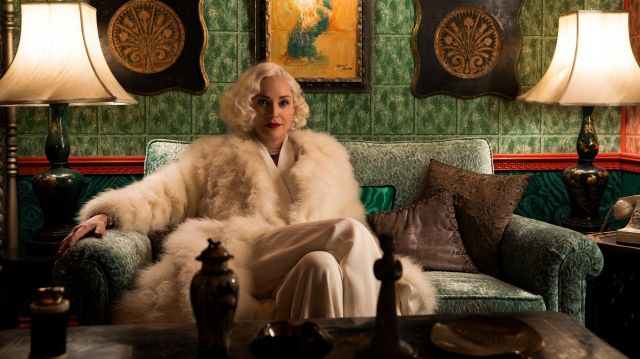 White Fur Coat of Lenore Osgood (Sharon Stone) in Ratched (S01E01)