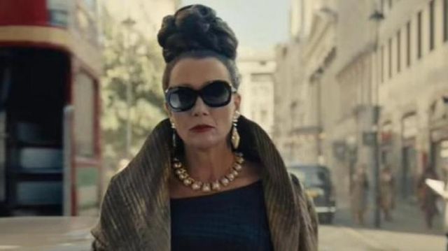 Golden coat worn by Baroness (Emma Thompson) as seen in Cruella movie