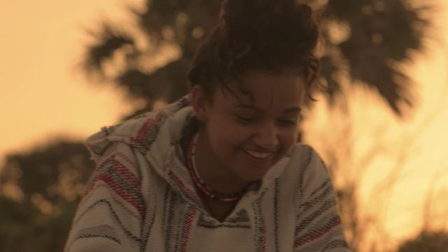 Orizaba Poncho Sweater worn by Kiara (Madison Bailey) as seen in Outer Banks (S01E01)