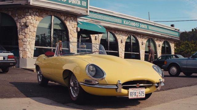 Yellow Jaguar E-Type driven by Jordan Belfort (Leonardo DiCaprio) as seen in The Wolf Of Wall Street