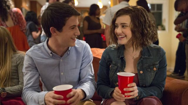 The shirt sky blue Clay Jensen (Dylan Minnette) in 13 Reasons Why