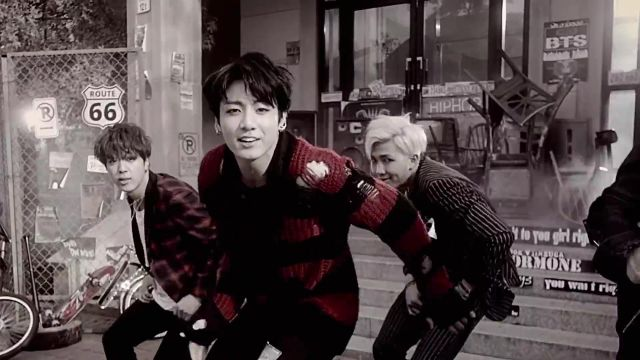 The striped sweater red and black Jungkook in the clip, War