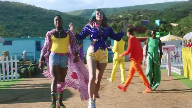 Purple shirt with stars pins and beige shoulders worn by Taylor Swift as seen in her You Need To Calm Down music video