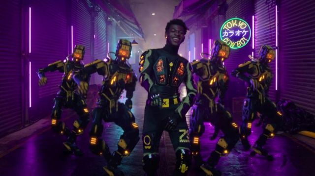 Black pants with yellow details worn by Lil Nas X in his Panini music Video