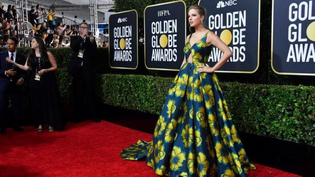 Green dress with yellow flowers worn by Taylor Swift at Golden Globes Awards January 2020